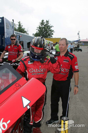 Jon Fogarty climbs out of the #99 GAINSCO/Bob Stallings Racing Pontiac Riley after winning the pole