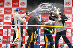 GT1 podium: champagne celebration