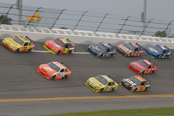 Clint Bowyer, Richard Childress Racing Chevrolet and Joey Logano, Joe Gibbs Racing Toyota lead a group of cars
