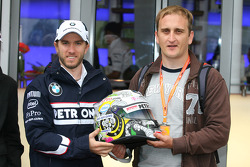 Nick Heidfeld, BMW Sauber F1 Team with a new helmet design competition winner Tamas Simon