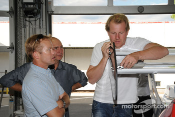 Driver Andreas Eriksson, aids videographers Scott Richardson and Tim Vincent with the placement of their video cameras