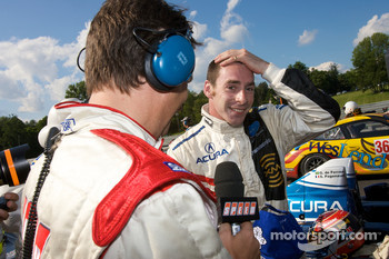 P1 and overall winner Simon Pagenaud celebrates with Justin Bell