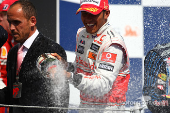Podium: race winner Lewis Hamilton, McLaren Mercedes, celebrates with champagne