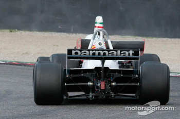 Joaquin Folch, Brabham BT49 closes in on Burani's Ferrari 312