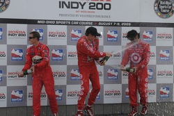 Podium: winner Scott Dixon, second place Ryan Briscoe, third place Dario Franchitti
