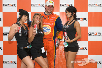 Podium: race winner Andrew Ranger in charming company