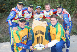 Tim Horan (front right), the 1999 Rugby World Cup winning outside centre, presents Jarmo Lehtinen with a commemorative Australia Rugby Union shirt to celebrate the Finnish co-driver's 100th WRC start