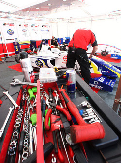 Mechanic works on the car of Alex Brundle