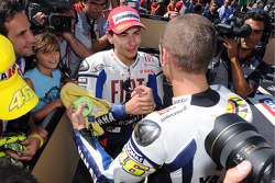 Race winner Valentino Rossi, Fiat Yamaha Team celebrates with second place Jorge Lorenzo, Fiat Yamaha Team