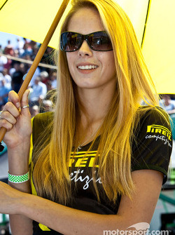 A Pirelli umbrella girl on pit road