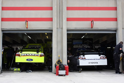 Cars of Paul Menard and Robby Gordon parked side by side