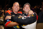 Tony Stewart, driver of the #14 celebrates with a crew member after winning