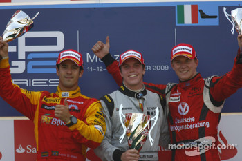 Luiz Razia celebrates his victory on the podium with Lucas Di Grassi and Nico Hulkenberg