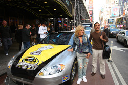 Fans pose with a NASCAR Sprint Cup Series car