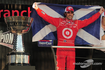 Dario Franchitti on the stage with the Indy Racing League championship trophy
