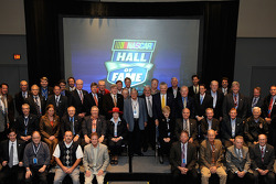 The NASCAR Hall of Fame voting panel, consisting of 50 members (the entire Nominating Committee, 14 media members, four manufacturer representatives, nine retired competitors including drivers, owners, crew chiefs and two recognized industry leaders) pose