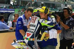 Pole winner Valentino Rossi, Fiat Yamaha Team celebrates with second place Jorge Lorenzo, Fiat Yamaha Team