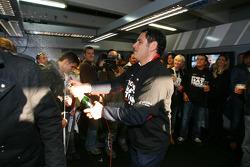 Hans-Jurgen Abt, Teamchef Abt-Audi spraying champagne in the Abt Audi pitbox