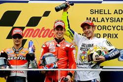 Podium: race winner Casey Stoner, Ducati Marlboro Team with second place Dani Pedrosa, Repsol Honda Team, third place and 2009 MotoGP champion Valentino Rossi, Fiat Yamaha Team