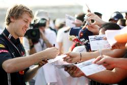 Sebastian Vettel, Red Bull Racing signs autographs