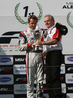 Jonathan Palmer Motorsport Vision Chief Executive presents 2009 F2 Champion Andy Soucek with his Championship trophy