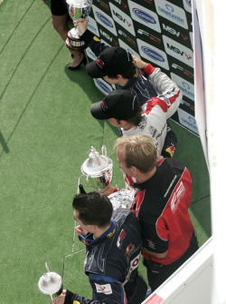 2009 F2 Champion Andy Soucek, Robert Wickens and Mikhail Aleshin celebrate on the podium