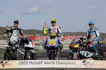 MotoGP 2009 world champion Valentino Rossi, Fiat Yamaha Team, with 250cc champion Hiroshi Aoyama, and 125cc champion Julian Simon