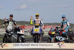 MotoGP 2009 world champion Valentino Rossi, Fiat Yamaha Team, with 250cc champion Hiroshi Aoyama, and 125cc champion Julian Simon