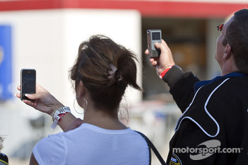 Fans try to get a photo of their favorite drivers