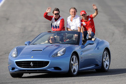 Fernando Alonso, Luca di Montezemolo and Felipe Massa in a Ferrari California