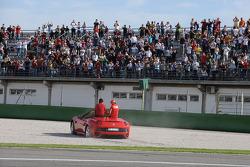 Luca di Montezemolo drives Felipe Massa and Fernando Alonso around the track in a Ferrari California: oops, stuck in the gravel