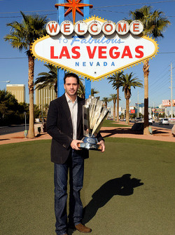 2009 NASCAR Sprint Cup Series Champion Jimmie Johnson poses with the trophy