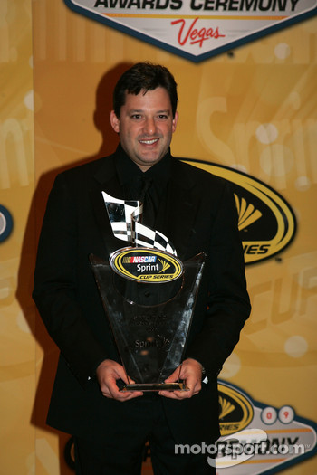 Tony Stewart with his award for sixth place in the Chase for the NASCAR Sprint Cup