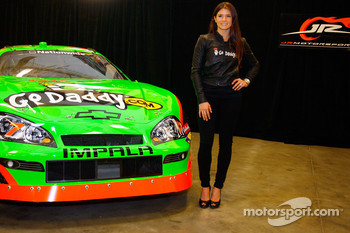 JR Motorsports driver Danica Patrick stands next to the No. 7 NASCAR Nationwide Series GoDaddy.com Chevrolet
