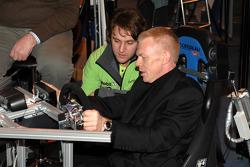 Harry Vaulkhard shows BTCC Commentator Alan Hyde how to drive a BTCC car on the simulator