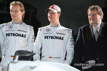 Nico Rosberg, Michael Schumacher and Norbert Haug