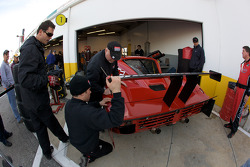 GAINSCO/ Bob Stallings Racing team members put the finishing touch on the rebuilt #99 Chevrolet Riley
