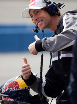 Travis Pastrana poses for a photo in the Red Bull pit stall