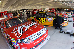 The cars sit in the garage before practice