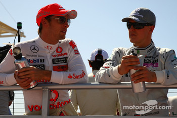 Jenson Button, McLaren Mercedes and Michael Schumacher, Mercedes GP