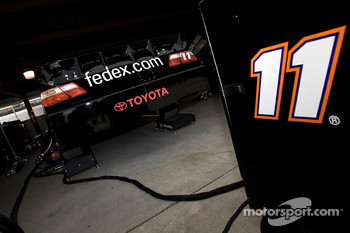 The No. 11 FedEx Toyota sits in the garage