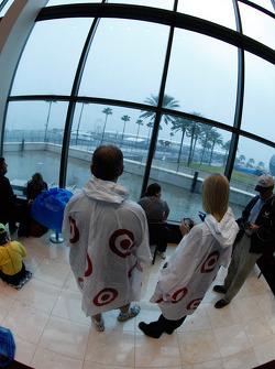 Fans take shelter inside while heavy rain falls outside