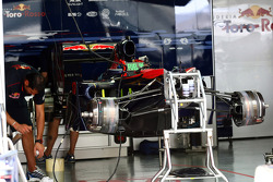 Toro Rosso team work on their cars