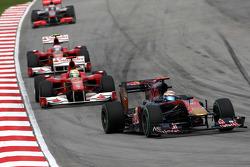 Sebastien Buemi, Scuderia Toro Rosso leads Felipe Massa, Scuderia Ferrari