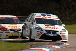 Tom Chilton Team AON Ford Focus leads Gordon Shedden Honda Racing Honda Civic