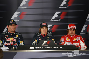 Pole winner Sebastian Vettel, Red Bull Racing, with second place Mark Webber, Red Bull Racing, and third place Fernando Alonso, Scuderia Ferrari