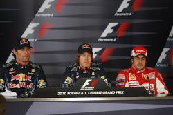 Pole winner Sebastian Vettel, Red Bull Racing, with second place Mark Webber, Red Bull Racing, and third place Fernando Alonso, Scuderia Ferrari