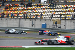 Sebastian Vettel, Red Bull Racing leads Michael Schumacher, Mercedes GP