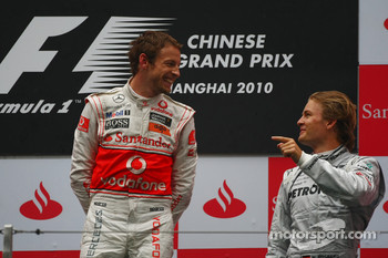 Podium: race winner Jenson Button, McLaren Mercedes, with third place Nico Rosberg, Mercedes GP
