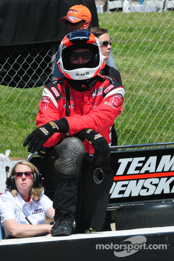 One of Helio Castroneves crew member's watches the race